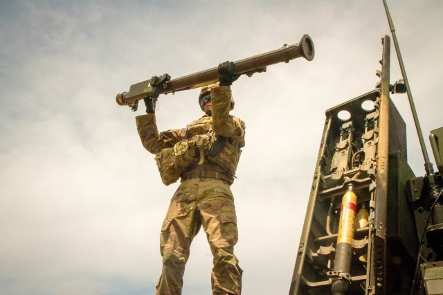 A Soldier with the 35th Air Defense Artillery Brigade loads a Stinger onto an Avenger Air Defense System during a live fire training exercise at Pacific Missile Range Facility Barking Sands, July 24, 2018.