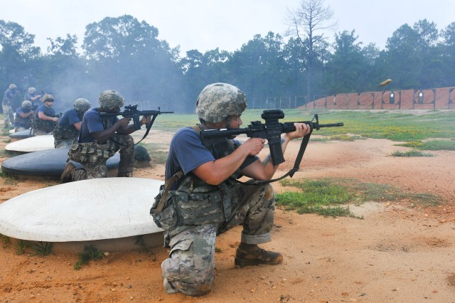Paratroopers assigned to the 1st Battalion, 505th Parachute Infantry Regiment, 3rd Brigade Combat Team, 82nd Airborne Division conduct a live-fire stress shoot station during the brigade's Best Squad Competition conducted August 21 on Fort Bragg.