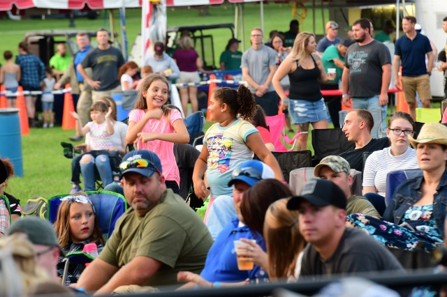 Two young fans in the crowd dance to the music of Parmalee.