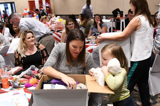 Fort Drum Mothers To Be Showered With Gifts At A Party In Their