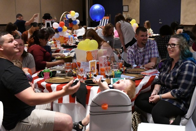 "The Commons ballroom was decorated in a circus theme Aug. 22 as 39 expectant mothers at Fort Drum were invited to an exclusive baby shower. Hosted by the non-profit Operation Shower with the theme ""The Greatest Shower on Earth,"" attendees were treated to a pasta and pizza lunch, shower games, raffles and more. (Photo by Mike Strasser, Fort Drum Garrison Public Affairs)"