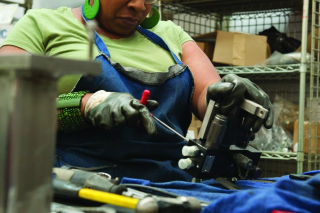 Leslie Turner-Johnson assembles a ramp manifold for a Stryker in the Hydraulic Systems Branch at Anniston Army Depot.
