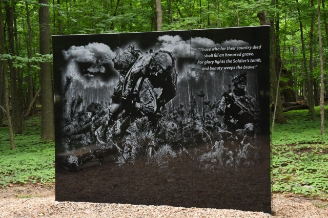 The newest addition to Fort Drum's Memorial Park - Survivor Park - was completed in November 2017. The black granite monochrome mural depicts a 10th Mountain Division (LI) Soldier carrying a comrade on his shoulders. The design was a collaboration between Brian O'Keefe, engineer technician, and Jeff Fox, illustrator, both with Fort Drum Public Works. The monument stands seven feet tall and nine feet across, and bears a quote by American poet Joseph Rodman Drake. There are two stone benches on both sides for visitors to sit. Community members attending the inaugural Memorial to Monument Run on Sept. 29 will have a chance to view all the sites at Memorial Park. (Photo by Mike Strasser, Fort Drum Garrison Public Affairs)