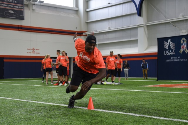 Staff Sgt. Brandon Vereen, U.S. Army Space and Missile Defense Command/Army Forces Strategic Command, cuts around a cone in the three-cone shuttle portion of the Broncos and USAA NFL Training Camp competition for service members Aug. 21 at the Denver Broncos' University of Colorado Health Training Center Fieldhouse in Englewood, Colorado.