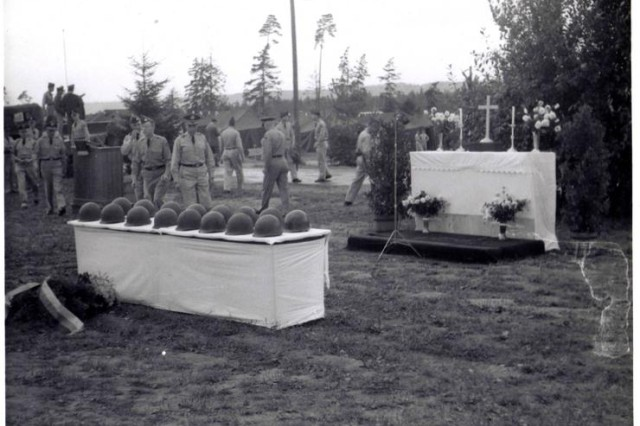The table with the sixteen helmets in front of the altar. The memorial service for the victims of the accident was held Sept. 4, 1960. Photo by Staff Sgt. Lowell Fox. Donation by Farley Fox. Photo courtesy of Frank da Cruz.