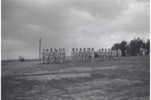 Soldiers in attendance at the ceremony. The Soldiers of the 3rd Armored Division assembled with gaps in the ranks where their fellow Soldiers would have stood. Photo by Staff Sgt. Lowell Fox. Donation by Farley Fox. Photo courtesy of Frank da Cruz.