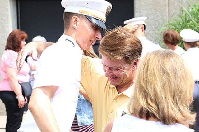 A Class of 2022 cadet celebrates with his family after officially joining the USMA Corps of Cadet during the Acceptance Day Parade Aug. 18, 2018. (U.S. Army photo by Brandon O'Connor)