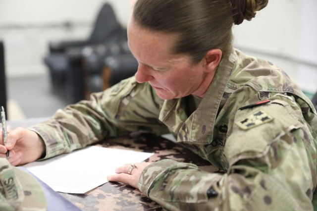 1st Sgt. Apryl Williams, senior enlisted leader for Company D, 52nd Brigade Engineer Battalion, 2nd Infantry Brigade Combat Team, 4th Infantry Division, takes a practice test, Aug. 3, 2018, during a study session in Kandahar Airfield, Afghanistan in preparation for the Sergeant Audie Murphy Club board.