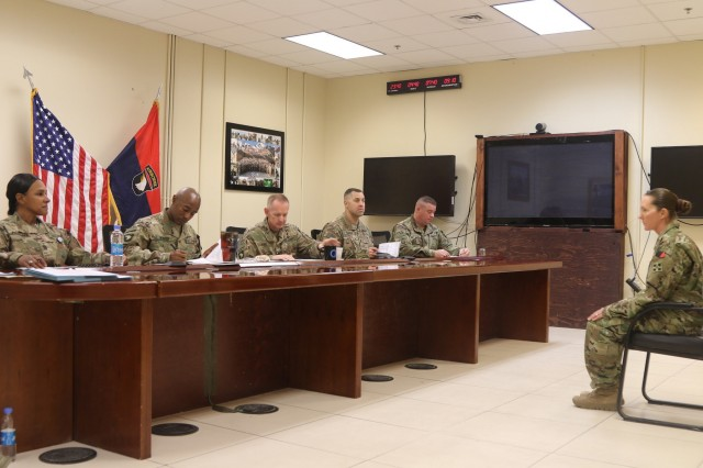 First Sgt. Apryl Williams, senior enlisted leader for Company D, 52nd Brigade Engineer Battalion, 2nd Infantry Brigade Combat Team, 4th Infantry Division, answers questions at her board appearance during the Sergeant Audie Murphy board in Bagram Airfield, Afghanistan.