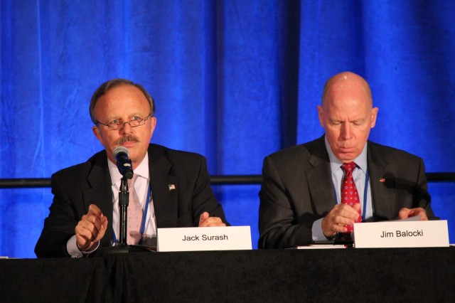 "Addressing several thousand energy professionals at the Energy Exchange 2018 in Cleveland, Ohio, Acting Deputy Assistant Secretary of the Army for Energy and Sustainability, Mr. J.E. ""Jack"" Surash discusses the criticality of maintaining energy resilience at Army installations. To his left is the Deputy Assistant Secretary of the Navy, Jim Balocki."