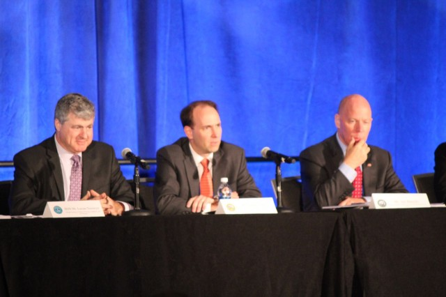 Mr. Jordan Gillis, Acting Assistant Secretary of the Army for Installations, Energy and Environment discusses devising and implementing installation energy plans for resilience at this year's Energy Exchange in Cleveland, Ohio. To his left is Hon. Lucian Niemeyer, Assistant Secretary of Defense for Energy, Installations and Environment. To his right is James Balocki, Deputy Assistant Secretary of the Navy for Installations and Facilities.