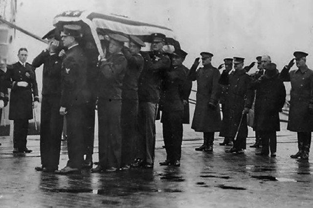 Body bearers carry the unknown Soldier from the USS Olympia to to a horse-drawn caisson that transported the body to the U.S. Capitol on Nov. 9, 1921. Among the saluting officers is Gen. John Pershing, who commanded the American Expeditionary Forces during World War I.