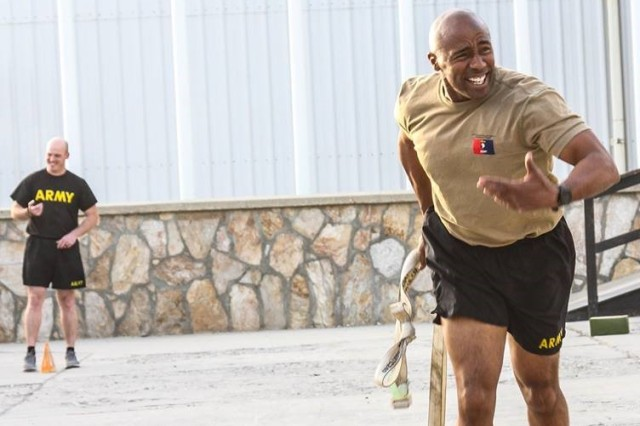 Command Sgt. Maj. Anthony McAdoo of the 101st Airborne Division (Air Assault) Resolute Support Sustainment Brigade participates in the sprint/drag/carry event for the Army Combat Fitness Test in Bagram, Afghanistan 14 August.