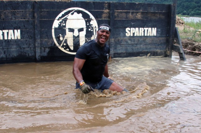 INJE, Republic of Korea -- Sgt. Maj. Tommie Jones, a native of Middletown, Ohio, and logistics sergeant major with 2nd Infantry Division/ROK-U.S. Combined Division, emerges from the muddy water during the 2018 Spartan Race Aug. 25. CSMs and SGMs participated in the 2018 Spartan Race as a team-building exercise to inspire esprit de corps and challenge themselves, both physically and mentally.