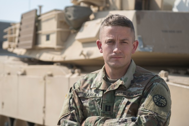 In addition to serving his country as a member of the Idaho Army National Guard Capt. Mike Barley also serve his community as a member of the Middleton Police Department in Middleton, Idaho.