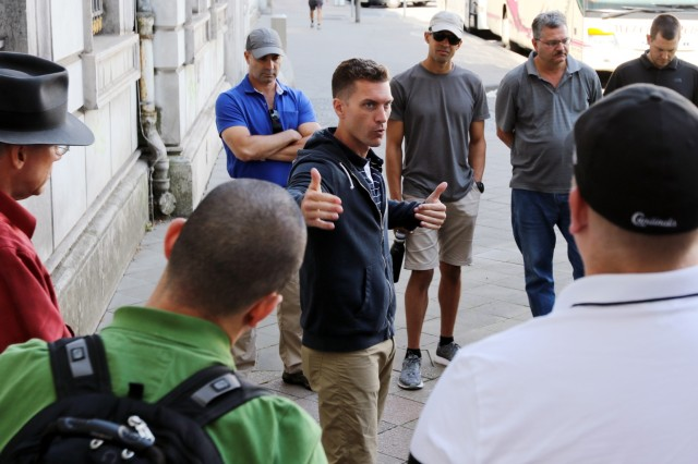 Capt. Michael Inscho, 361st Civil Affairs Brigade civil affairs officer, leads a discussion with 7th Mission Support Command junior officers, Aug. 18, 2018 in Aachen, Germany, through the U.S. Army's civil affairs operations in the city during World War II. A large portion of the group included officers from the 361st Civil Affairs Brigade, a subordinate brigade to the 7th MSC.The staff ride included two days of classroom instruction, Aug. 16-17, before visiting Aachen and the Huertgen Forest, Aug. 18-19.