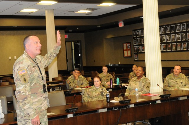 First Army Command Surgeon, Col. Lance Cordoni, addresses attendees at the First Army Medical Summit on Aug. 23 in the Pershing Conference Room of First Army headquarters on Rock Island Arsenal, Ill.
