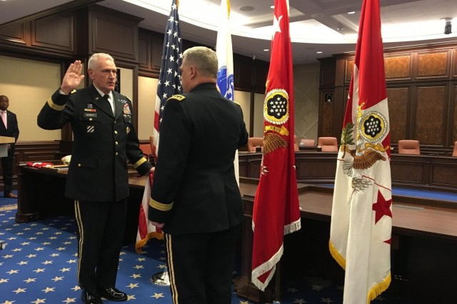 Gen. John M. Murray recites the commissioned officer oath of office during his promotion ceremony held at the newly appointed headquarters location for Army Futures Command in Austin, Texas, Aug. 24, 2018. U.S. Army Chief of Staff Gen. Mark A. Milley administered the oath and promoted Murray to the rank of four-star general on the same day as Army Futures Command's activation ceremony. (U.S. Army photo Staff Sgt. B. Nicole Mejia/Released)