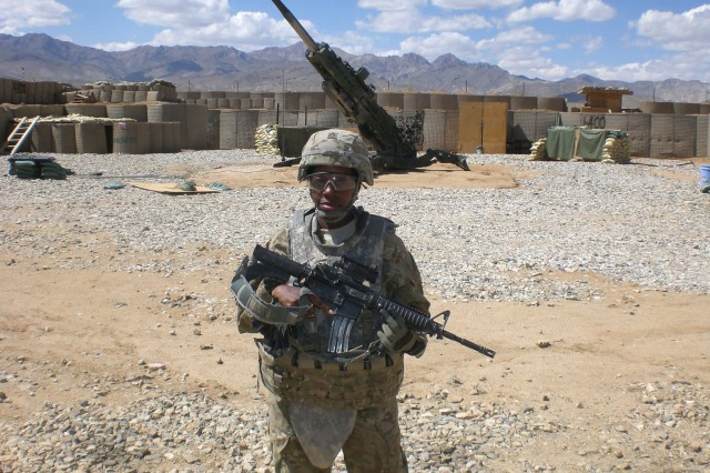 Sgt. Frist Class Yvette Edmonds, a religious affairs specialists, poses during a deployment to forward operating base Shank, Afghanistan, July 2011. (Courtesy photo)