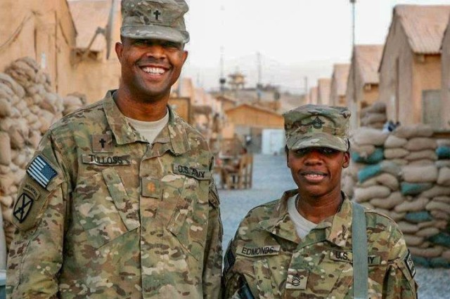 Sgt. Frist Class Yvette Edmonds (right), a religious affairs specialists, poses with fellow Soldier, during a deployment to forward operating base Shank, Afghanistan, July 2011. (Courtesy photo)