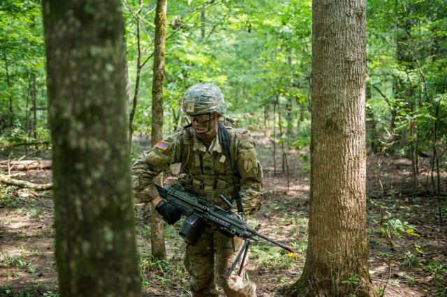 Ben Rogers takes part in a situational training exercise Aug. 13, 2018 near McBride's Bridge at Fort Benning, Ga.