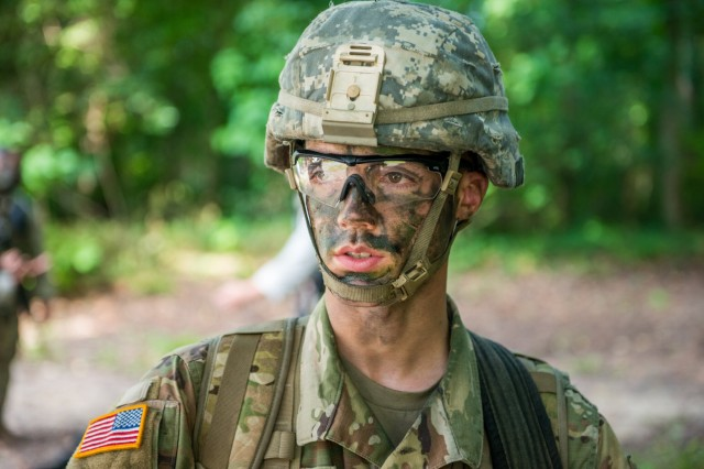 Jony Rogers takes part in a situational training exercise Aug. 13, 2018 near McBride's Bridge at Fort Benning, Ga.