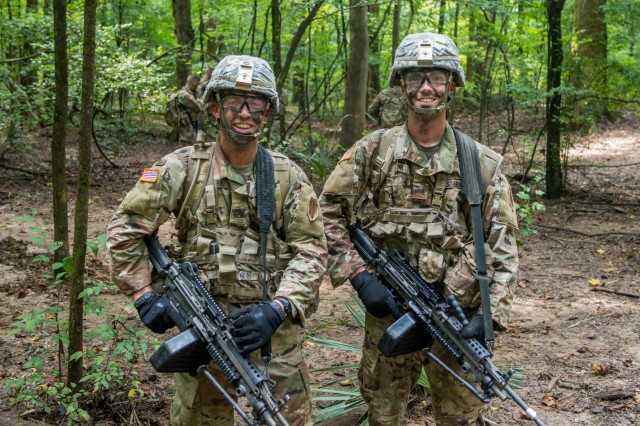Jony and Ben Rogers take part in a situational training exercise Aug. 13, 2018 near McBride's Bridge at Fort Benning, Ga. Jony and Ben, two brothers from Pensacola, Florida, by coincidence became members of the same company during Officer Candidate School, 3rd Battalion, 11th Infantry Regiment, at Fort Benning.