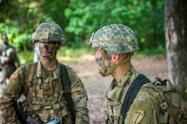 Jony and Ben Rogers takes part in a situational training exercise Aug. 13, 2018 near McBride's Bridge at Fort Benning, Ga.