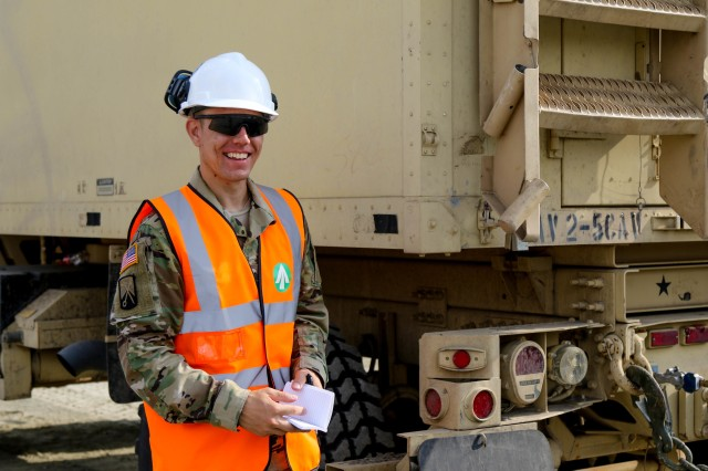 Sgt. Matthew Grobelch, a transportation management coordinator with the 839th Transportation Battalion, helps to load U.S. military cargo at the Port of Constanta, Romania, Aug. 24, 2018.