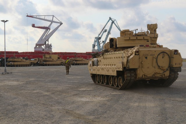 Soldiers with the 2nd Battalion, 5th Cavalry Regiment stage their Abrams Battle Tanks at the Port of Constanta, Romania, Aug. 24, 2018 after downloading them from the USNS Carson City.