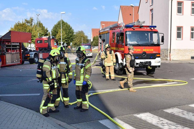 ANSBACH, Germany -- First Responders from the Ansbach Fire and Emergency Services Team assisted by police and CID law enforcement officials evacuate and clear bldg. 5818 on Katterbach Kaserne prior to a the arrival of a Hazardous Materials (HAZMAT) team Wednesday, August 22. Once the HAZMAT Team were on site they entered the building and removed a potentially lethal parcel, placed as part of an emergency scenario scripted by the Ansbach Emergency Management Office. The annual exercise, which involved simulating a terrorist breach on Katterbach Kaserne to plant potentially lethal toxins disguised as packages and timed for release when discovered, as well as other occurring emergency events was designed to prepare teams and individuals for similar real-world events. To learn more about the people and facilities of the U.S. Army Garrison Ansbach (USAG Ansbach) and the people they support in Ansbach, Katterbach and Illesheim, visit the community website at http://ansbach.army.mil