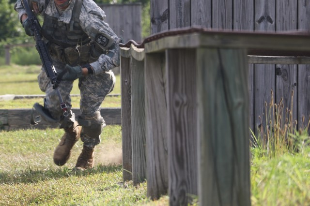 A 1st Platoon, Bravo Company, 6th Regiment, Basic Camp Cadet practices small unit tactics at Fort Knox July 19.