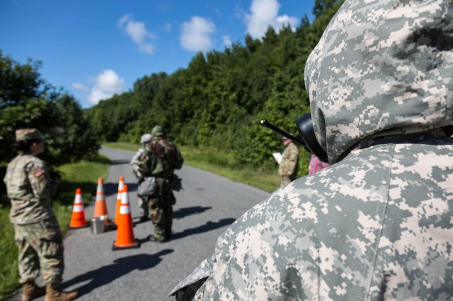 "A Soldier assigned to the 1st Area Medical Laboratory, a subordinate unit from the 20th Chemical Biological Radiological Nuclear, Explosives (CBRNE)  Command, uses a mobile hand radio to notify the arrival of a ""hazardous"" sample during their Culminating Training Event at Lauderick Creek near Aberdeen Proving Ground, Maryland on Aug. 14. The purpose of the exercise is to practice on mission critical tasks in order to increase the unit's deployment readiness. Some of these tasks were tactical movement, reaction to enemy fire, casualty care, detection of chemical, biological, and radiological threats, and shipment of theater-validated samples to specific U.S. labs. (U.S. Army photo by Pfc. Joshua Hugley, 55th Signal Company)"