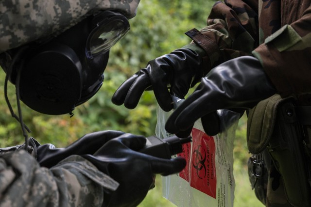 A Soldier assigned to the 1st Area Medical Laboratory, a subordinate unit from the 20th Chemical Biological Radiological Nuclear, Explosives (CBRNE)  Command, analyzes an unknown substance during a training exercise, Aberdeen Proving Ground, Md., Aug. 14, 2018. The purpose of the exercise is to practice on mission critical tasks in order to increase the unit's deployment readiness. Some of these tasks were tactical movement, reaction to enemy fire, casualty care, detection of chemical, biological, and radiological threats, and shipment of theater-validated samples to specific U.S. labs. (U.S. Army photo by Pfc. Joshua Hugley)