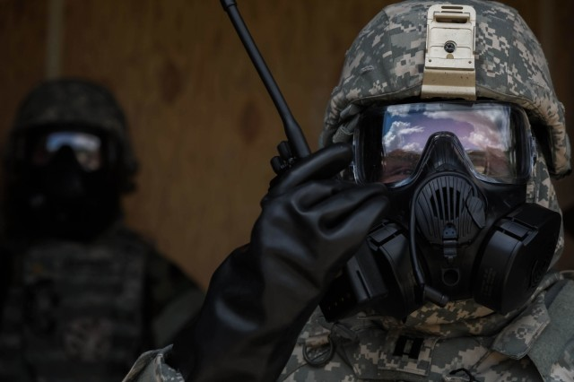 A Soldier assigned to the 1st Area Medical Laboratory, a subordinate unit from the 20th Chemical, Biological, Radiological, Nuclear, Explosives (CBRNE)  Command, monitors the radio during a training exercise, Aberdeen Proving Ground, Md., Aug. 14, 2018. The purpose of the exercise is to practice on mission critical tasks in order to increase the unit's deployment readiness. Some of these tasks were tactical movement, reaction to enemy fire, casualty care, detection of chemical, biological, and radiological threats, and shipment of theater-validated samples to specific U.S. labs. (U.S. Army photo by Pfc. Joshua Hugley)