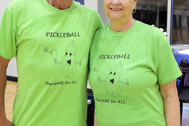 "Pickelball03: Bruce and Laura Bower model the ""Pickleball"" shirt that Bruce designed. Despite the confusing name, pickleball has arguably become the fastest growing sport in America. (Photo by G. Anthonie Riis 