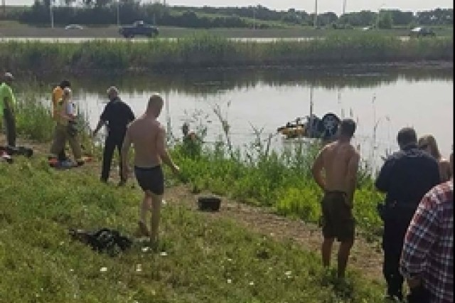 Cpl. Nathan Jennings of Machesney Park pulled an unconscious woman out of a submerged overturned vehicle (pictured) and carried the woman to the side of the pond where other rescuers performed CPR after a single car accident on Aug. 3 in Huntley, Ill..