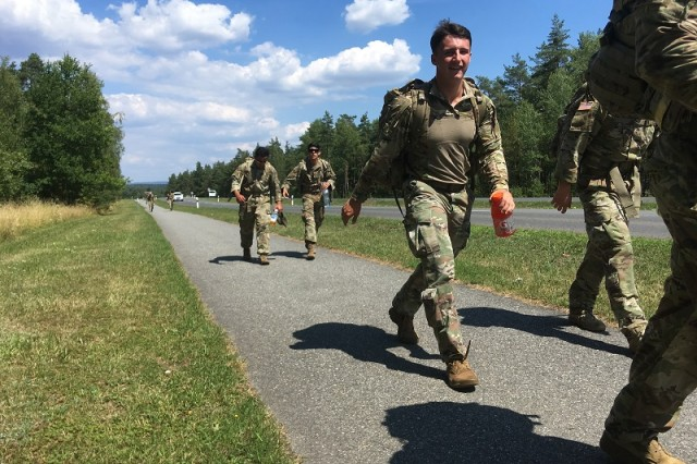 U.S. Soldiers participate in a 12-kilometer ruck march, one of the events that are necessary to achieve the German Armed Forces Proficiency Badge.