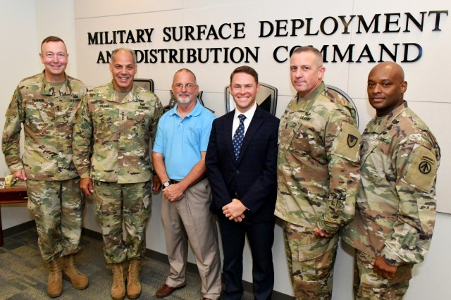 The commanding general of Army Materiel Command, Gen. Gustave F. Perna, recognized Philip Sadler (center left), Military Surface Deployment and Distribution Command (SDDC) Team Member of the Quarter, and David Gable (center right), SDDC Supervisor of the Quarter, during his Aug. 28, 2018 visit to SDDC headquarters.