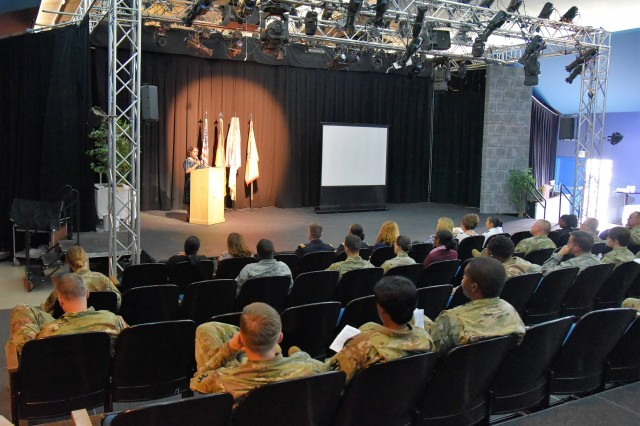 Mayor Genoveva Garcia Calloway from San Pablo, Calif. speaks at a Women's Equality Day event hosted by 21st Theater Sustainment Command at KMC Onstage, Kleber Kaserne, Aug. 30.