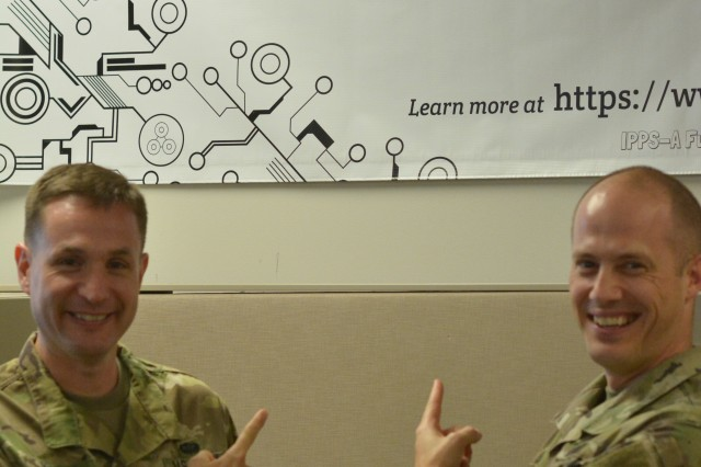 Col. Michael McTigue, Adjutant General School commandant (left) and Col. Daryl Morse, TRADOC capabilities manager, pose in front of the IPPS-A banner. They will be helping to implement the new Personnel and Pay System on Fort Jackson.