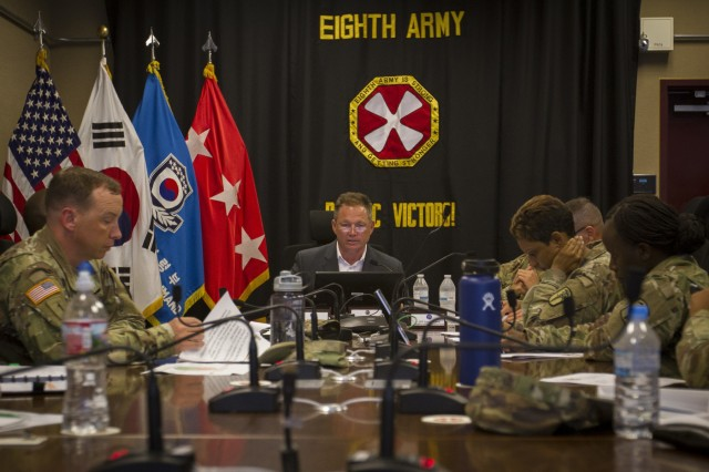 Retired Army Col. Trey Johnson, the U.S. Army Pacific Project Greenbook lead talks to Soldiers at the Eighth Army headquarters, Camp Humphreys, South Korea, July 12. Johnson spoke about U.S. Army Pacific's Project Greenbook, a training initiative designed to develop more resilient, adaptive and innovative Soldiers and leaders. Johnson said he could see Project Greenbook being especially relevant to units in South Korea, where many Soldiers serve a one-year tour. He thinks this program could decrease the time it takes to familiarize and train new Soldiers, increasing their overall effectiveness. (U.S. Army photo by Pfc. Adeline Witherspoon)