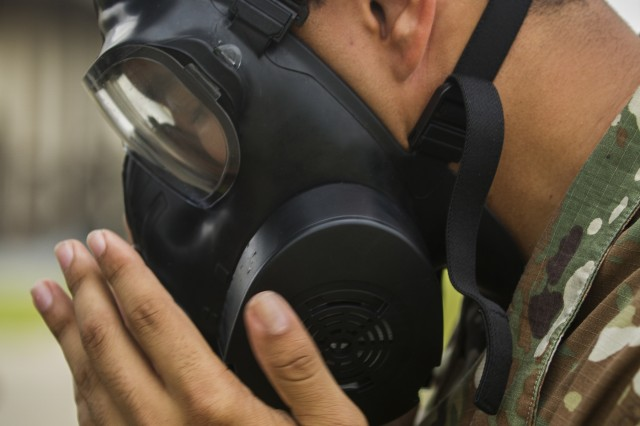 A U.S. Army Soldier, assigned to Company B, 602nd Aviation Support Battalion, 2nd Combat Aviation Brigade, 2nd Infantry Division, seals his mask before entering the gas chamber during chemical, biological, radiological and nuclear defense training on Camp Humphreys, Republic of Korea, May 27. The training familiarizes Soldiers with their protective equipment in the event of a CBRN incident. (U.S. Army photo by Spc. Adeline Witherspoon, 20th Public Affairs Detachment)