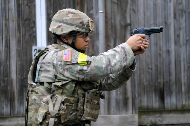 Staff Sgt. Steven Vinton, assigned to 30th Medical Brigade, fires an M9 pistol during a qualification range for the 2018 21st Theater Sustainment Command Best Medic Competition August 27, 2018 at Baumholder, Germany. The winners of this four day competition will move on to the U.S. Army Best Medic competition held in Texas later this year. #21BMC2018 #VictoryMedics #FirstInSupport (U.S. Army photo by Sgt. Benjamin Northcutt 21st Theater Sustainment Command)