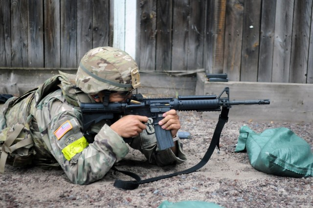 Staff Sgt. Steven Vinton, assigned to 30th Medical Brigade, fires an M4 rifle during a qualification range for the 2018 21st Theater Sustainment Command Best Medic Competition August 27, 2018 at Baumholder, Germany. The winners of this four day competition will move on to the U.S. Army Best Medic competition held in Texas later this year. #21BMC2018 #VictoryMedics #FirstInSupport (U.S. Army photo by Sgt. Benjamin Northcutt 21st Theater Sustainment Command)