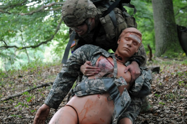 1st Lt. Keith Ammerman, assigned to 557th Medical Company, drags a simulated casualty during a Tactical Combat Casualty Care exercise for the 2018 21st Theater Sustainment Command Best Medic Competition August 27, 2018 at Baumholder, Germany.The winners of this four day competition will move on to the U.S. Army Best Medic competition held in Texas later this year.#21BMC2018 #FirstInSupport(U.S. Army photo by Sgt. Benjamin Northcutt 21st Theater Sustainment Command)
