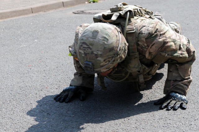 Sgt. Stephen Chawporn, assigned to 18th Military Police Brigade, does one-minute of 8-count push-ups before a stress shoot during the 2018 21st Theater Sustainment Command Best Medic Competition August 28, 2018 at Baumholder, Germany.During the second day of the competition competitors encountered a CBRN event, stress shoot, mystery event, and daily non-combat related tasks.#21BMC2018  #FirstInSupport #StrongEurope #18thMPBDE (U.S. Army photo by Sgt. Benjamin Northcutt 21st Theater Sustainment Command)