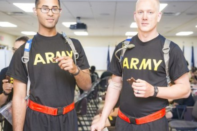 Two U.S. Army Soldiers eat a version of the Performance Readiness Bar. The U.S. Army Research Institute of Environmental Medicine researchers will monitor them to test whether the bar affects bone density.