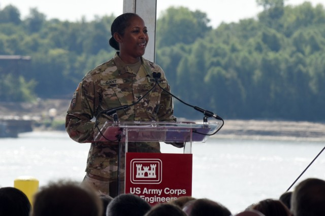 Col. Antoinette Gant, U.S. Army Corps of Engineers Louisville District commander delivers remarks at the ribbon-cutting ceremony for the Olmsted Locks and Dam, Aug. 30, 2018 in Olmsted, IL.The ceremony hosted by the U.S. Army Corps of Engineers, Louisville District, included a ceremonial lock through and the dedication of the wicket lifter barge. The Olmsted Locks and Dam project, which is replacing two older locks 52 and 53,  will bring reliable navigation to the Ohio River offering millions of dollars of economic gains annually.The Olmsted Locks and Dam is the largest Corps project since the Panama Canal. It consists of two 110-foot by 1,200-foot locks, which are located adjacent to the Illinois bank and a dam comprised of five tainter gates, which control the amount of water that flows downstream. Additionally, there are 140 wickets and a fixed weir.