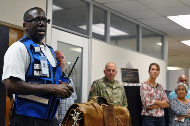 Carlton Bray, Anti-terrorism Officer, U.S. Army Medical Command Provost Marshal Office, conducts the after action discussion following an active shooter drill on August 29, 2018, at the U.S. Army Health Contracting Activity on Joint Base San Antonio. (U.S. Army Photo by Wesley Elliott, MEDCOM/OTSG)